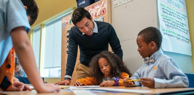 a teacher and children inside of a Success Academy classroom