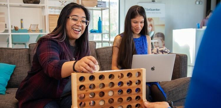 employees playing Connect Four in GoGuardian's El Segundo, CA, office