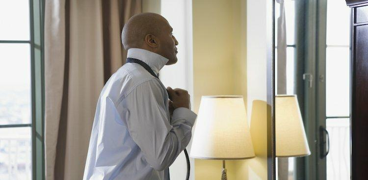 man getting dressed for job interview