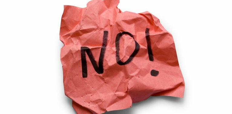 """no"" written on paper"