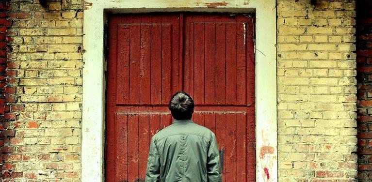 person at door