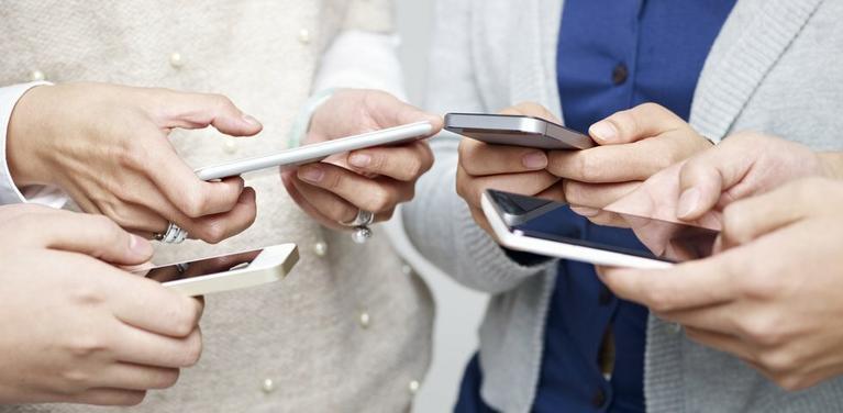 people holding phones