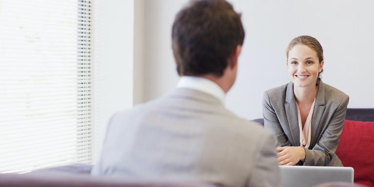 two people talking at a job interview in an office