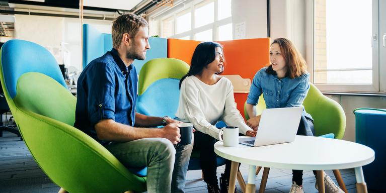 three people meeting in an office