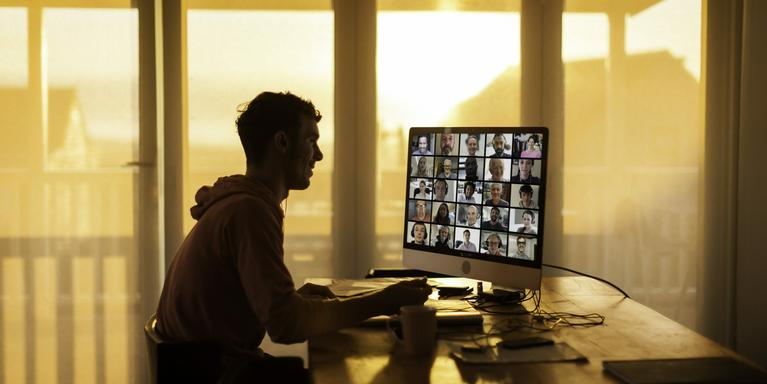 person on a video call with many coworkers