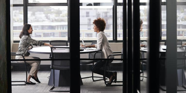 two people talking at job interview in a conference room