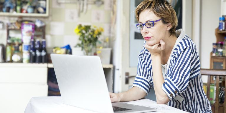 person at table on laptop