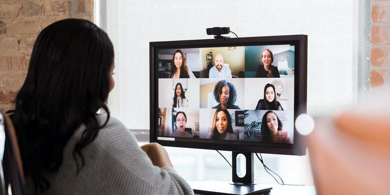 person sitting at a computer in a virtual meeting