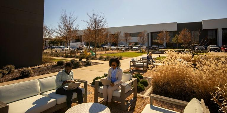 employees working outdoors in Samsung's Plano, TX, campus