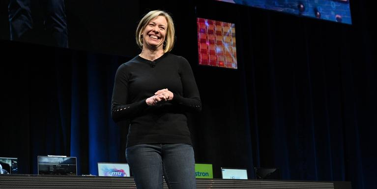 a blonde person giving a speech on stage at the technology conference CES