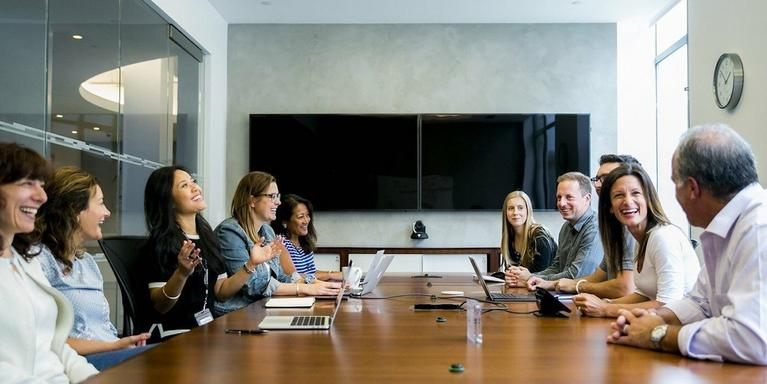 employees gathered in a conference room