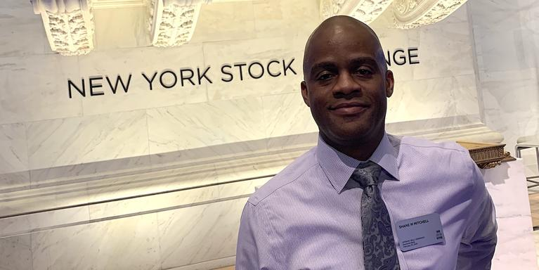 person standing inside of the New York Stock Exchange