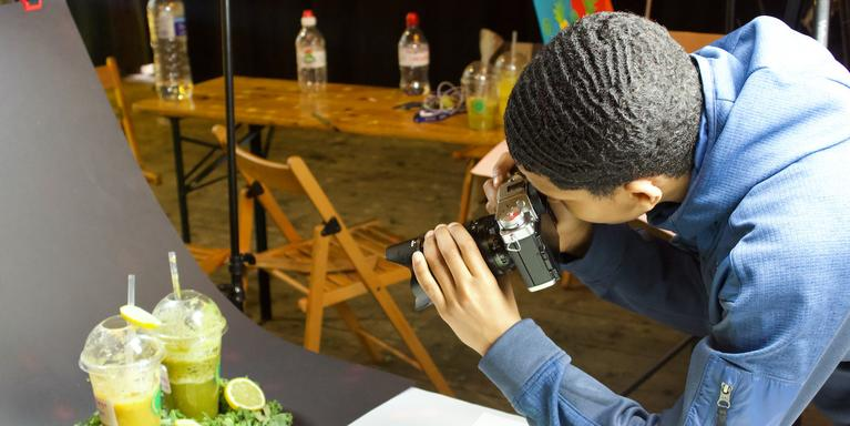 man taking a photograph of smoothies