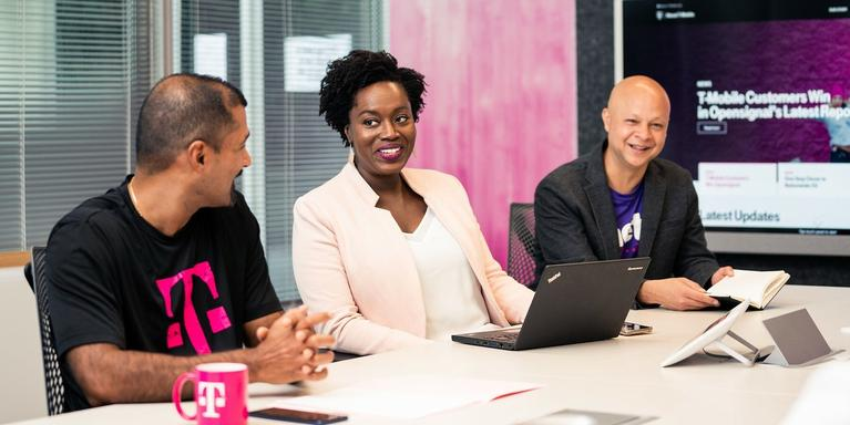 T-Mobile employees sitting in a conference room
