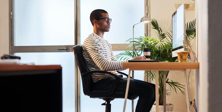person sitting at a desk in their home office