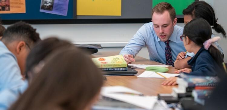 Joey Patterson, a teacher at Success Academy, with students