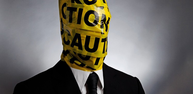 Man with caution tape
