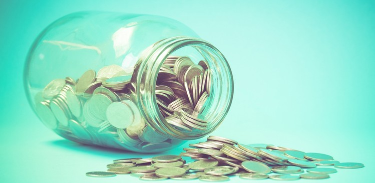 Money spilling out of jar
