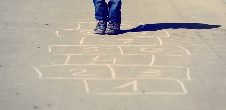 child playing hopscotch