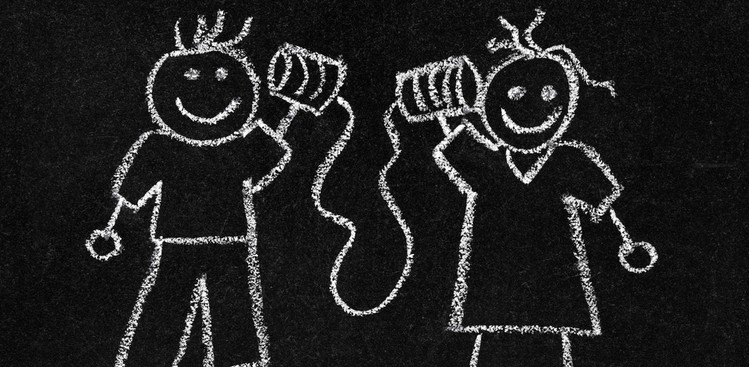Chalkboard drawing of people listening