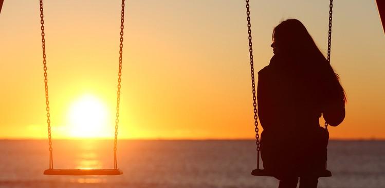 woman alone on swing