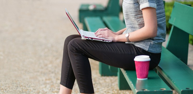 Woman drinking coffee and working