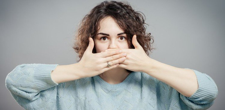 Woman covering mouth