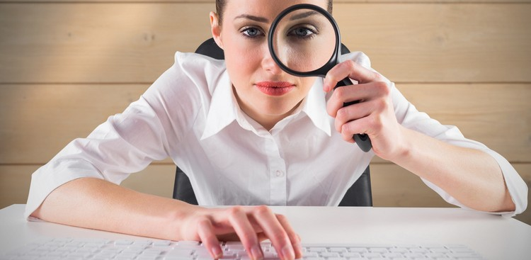 Woman using magnifying glass