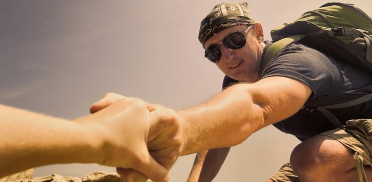 Hiker helping someone