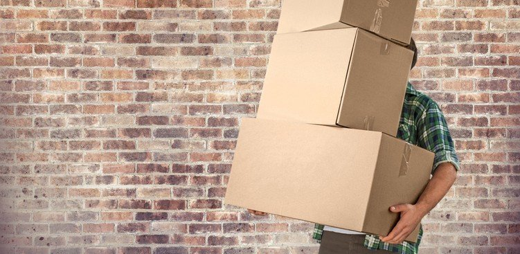 man holding boxes - Typical Relocation Package Average Relocation Package Examples