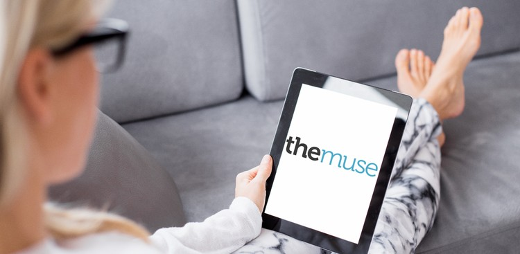 Woman using iPad on couch
