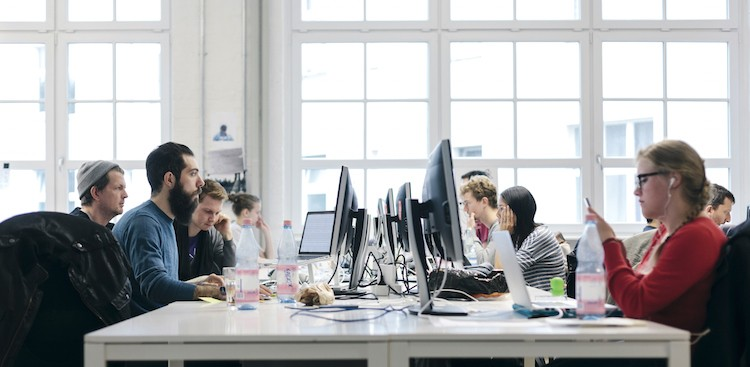 Science Says Who You Sit Next to at Work Matters