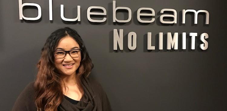 girl smiling bluebeam sign