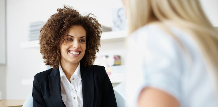 person smiling and talking in a job interview