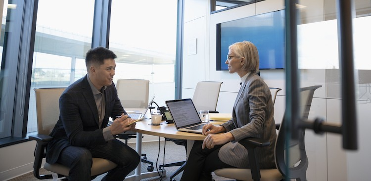two people chatting in an office