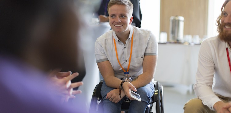 person in a wheelchair at a networking event