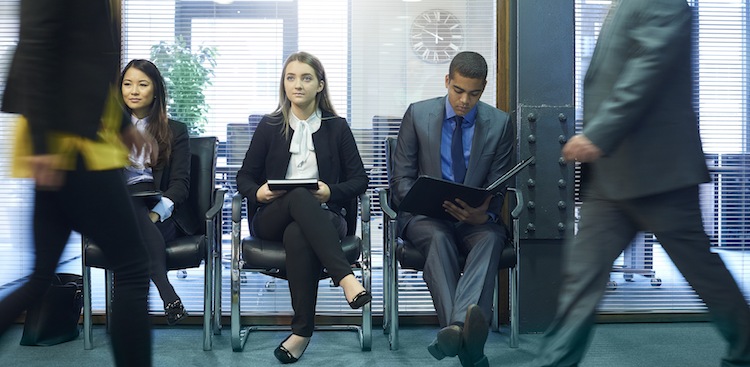 employees sitting in a row in an office