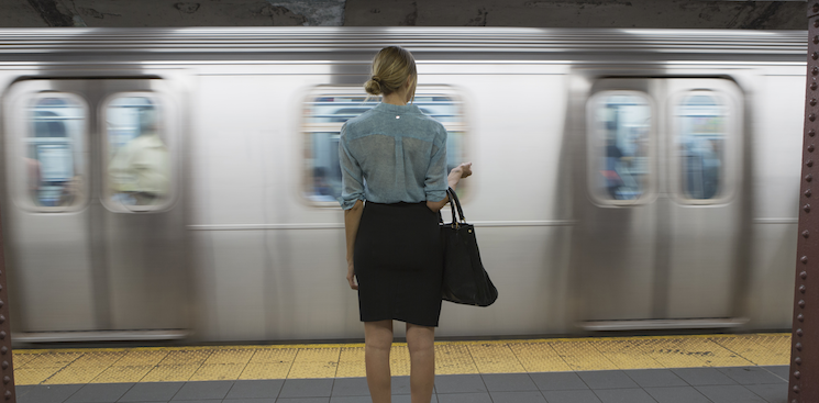 person standing on a subway platform