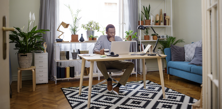 person working on a laptop in a home office