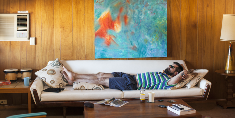 person stretched out on a couch relaxing