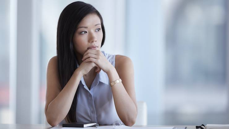 person staring off pensively at work