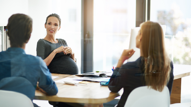 pregnant person speaking at the office